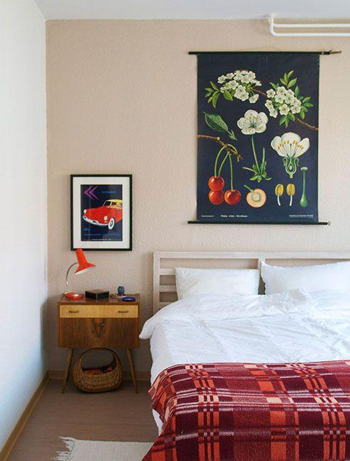 ikea bed frame...cherry tree artwork jung,koch,n quentell  A Vintage Shopkeeper's Home in Berlin | Design*Sponge