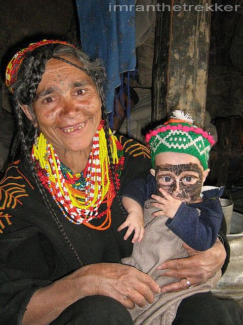 kalash woman with the baby. Pakistan by  Imran Schah  #world_cultures