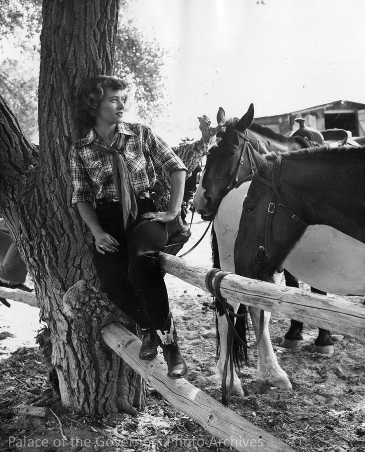 """cultwestern:  """" pogphotoarchives:  """" Cowgirl sitting on corral fence, Rancho Rio Grande near Espanola, New Mexico  Creator: New Mexico Tourism Bureau  Date: 1949  Negative Number HP.2007.20.386  """"  q  """""""