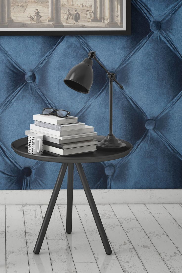 Velvet on the walls. This velvet effect wallpaper design brings a touch of luxury to your home. The rich blue colour combined with the button studded pattern adds character and sophistication. It's perfect for home offices and living room spaces.