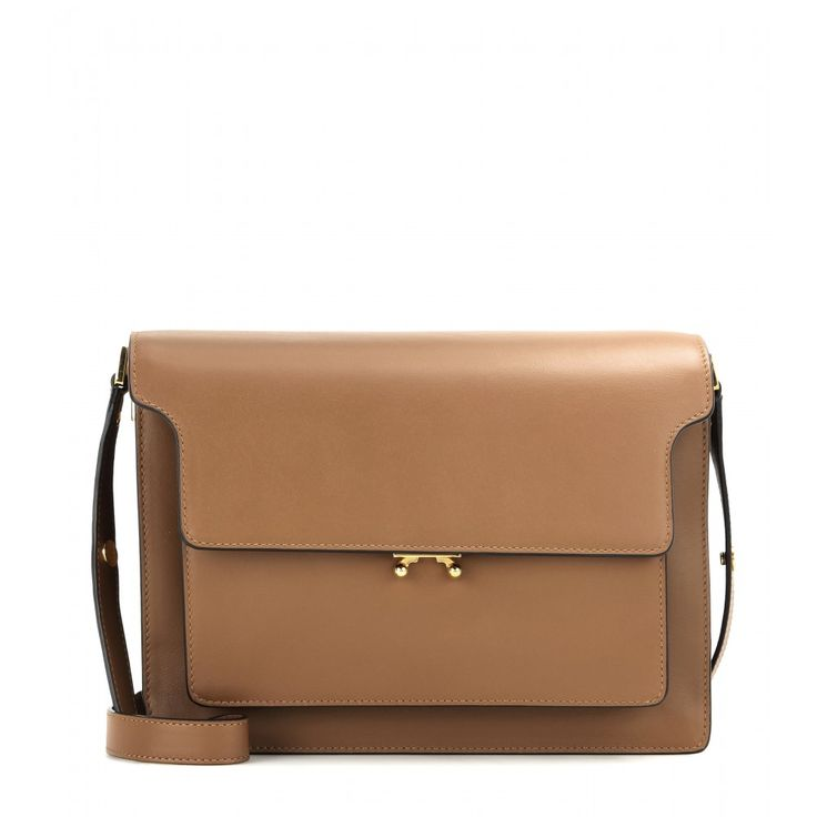 Marni - Trunk leather shoulder bag - Clean cut: Marni's 'Trunk' leather shoulder bag will carry you seamlessly through the season and beyond. Deceptively roomy, it boasts two zipped pouches and four internal compartments, plus a neutrally hued canvas lining. The adjustable strap means it can also be carried across the body for those errand-running off-duty days. seen @ www.mytheresa.com