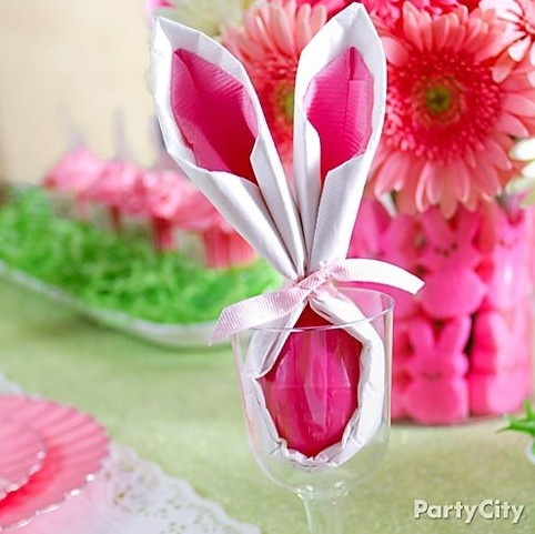 Surprise your guests with playful Easter bunny-ear napkins that double as a hiding place for secret candy eggs! Click for our how-to steps!