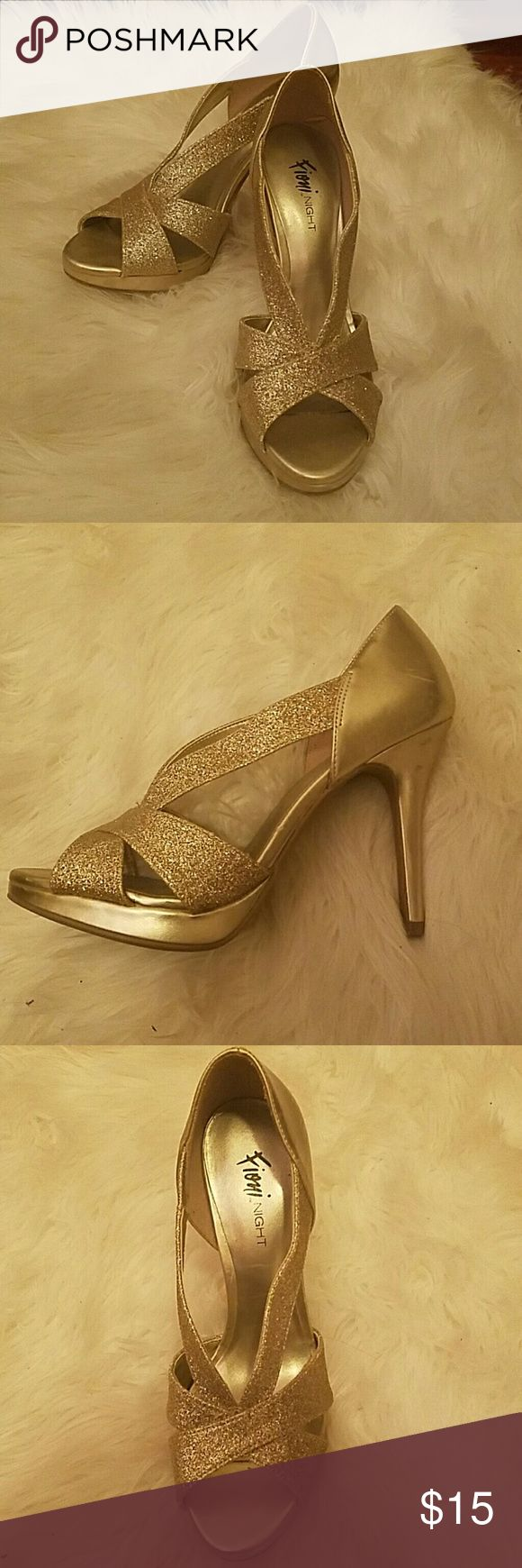 Fabulous Gold Sparkly Heels. Approx 3.5 inches. Only worn one for Prom. Perfect for any occasion. No marks or dagae to shoe. Just been left in my closet for a year. Shoes Heels
