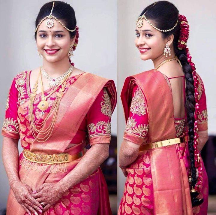 South Indian bride. Gold Indian bridal jewelry.Temple jewelry. Jhumkis. Pink silk kanchipuram sari.Braid with fresh jasmine flowers. Tamil bride. Telugu bride. Kannada bride. Hindu bride. Malayalee bride.Kerala bride.South Indian wedding.