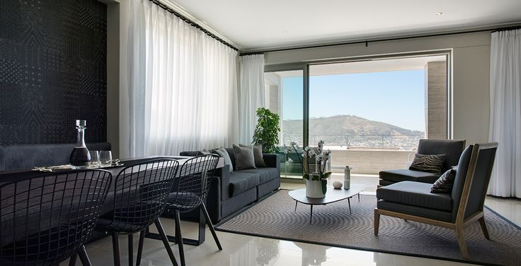 The furnished interior of one of the units.  The bench along the wall behind the dining room table was custom made.  #capetownproperty