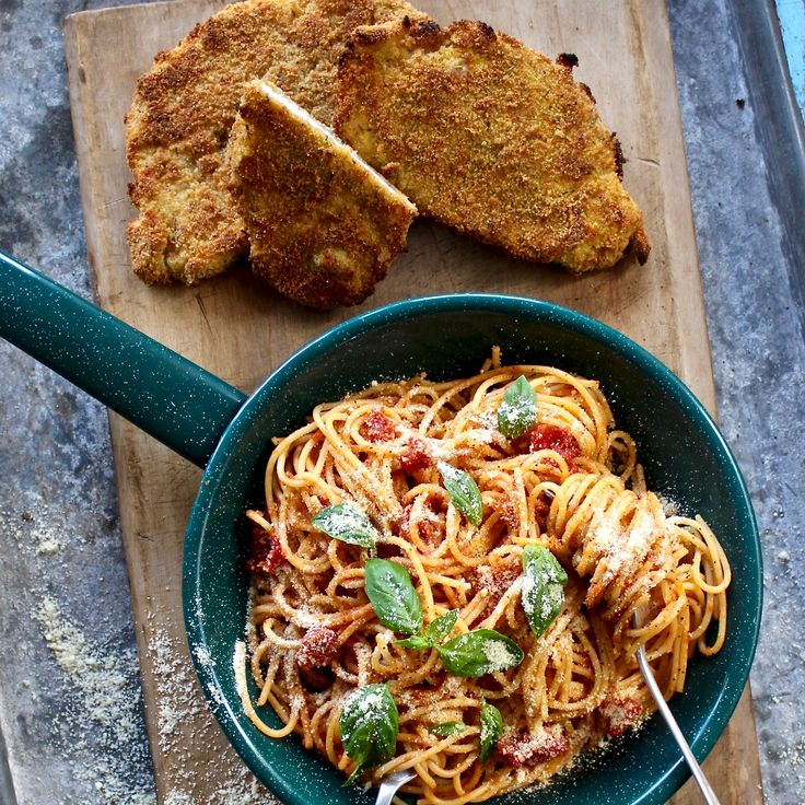 PARMESAN CHICKEN SCHNITZEL WITH SPAGHETTI POMODORO. Why go our for a cheap pub schnitty when you can make the real deal at home in just 30 minutes? Made with chicken coated in breadcrumbs, herbs and parmesan cheese. Served with a classic spaghetti pomodoro, made with crushed tomatoes and basil. 30 Minutes. What's not to love.