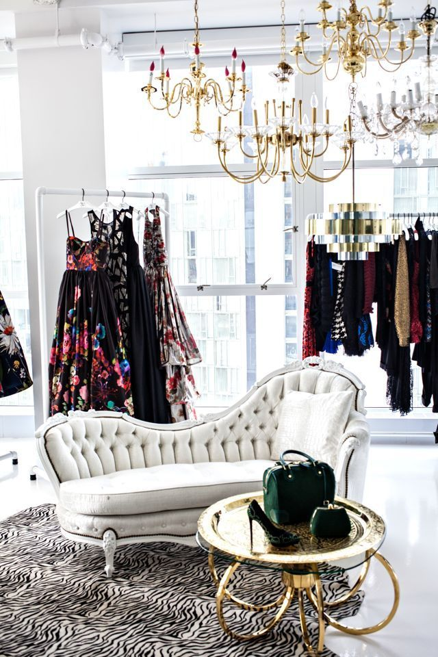 Beautiful clothes, chandeliers, and vintage furniture - what a fabulous scene.