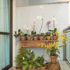 (2015) Apartamento Santa Rosa: Jardins translation missing: br.style.jardins.rústico por Escritório Ana Meirelles