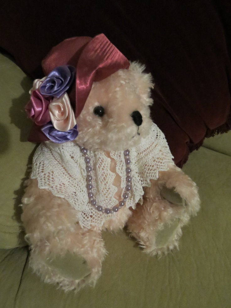 This beautiful bear was made by Dlorah Bears as a gift for my 60th Birthday.  Her name is Sybella.