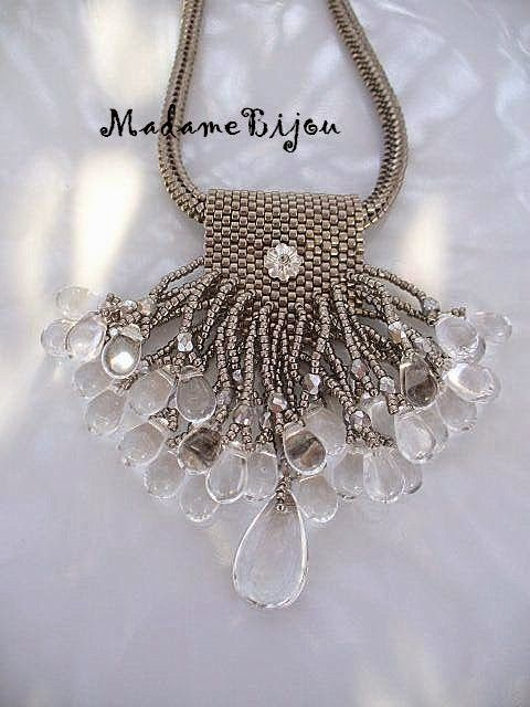 Madame bijou: Now it is a silver fringed :)