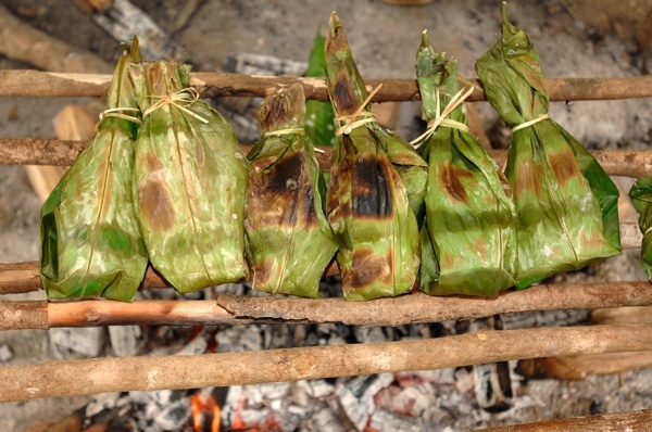 Maito de Telapia- Equador  Tilapia wrapped in a banana leaf & cooked over an open fire