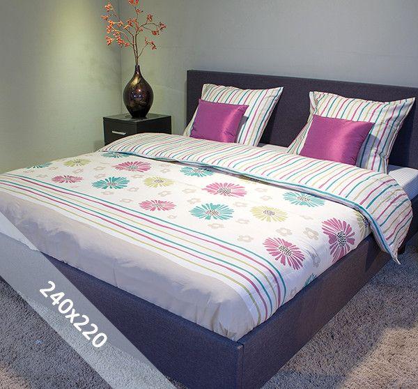Sofiben dekbedovertrek 'Ardice'. Een lits-jumeaux (240x220 cm) dekbedovertrek van 100% katoen satijn, voorzien van een rits. Het dekbedovertrek heeft als basis een ecru achtergrond met daarop bloemen en strepen in turquoise, oudroze en lichtgroen.