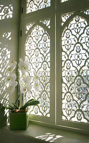 Large scale Moorish Leaves design for bookcase opening in entry