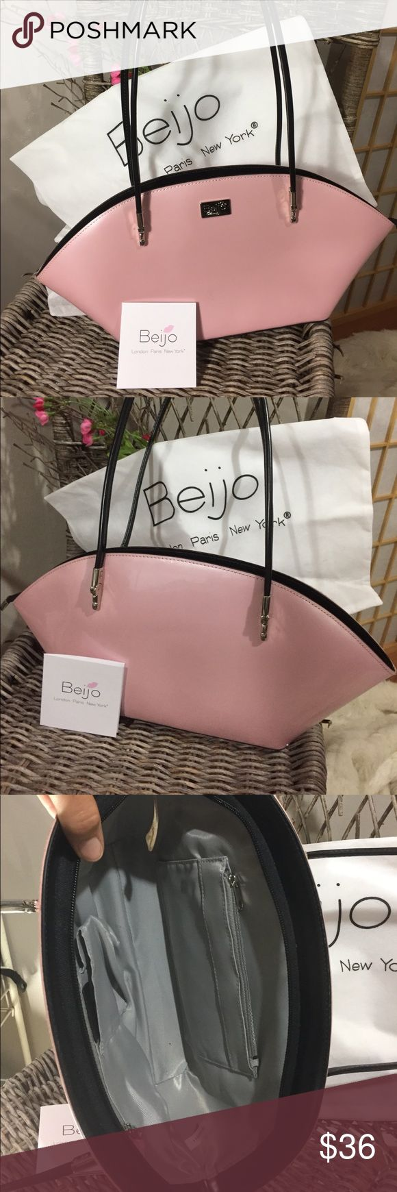 Beijo bag Brand new, never used from smoke free home. Included bag for storage. Light pink in color patent leather with black accents. Measures 16 at widest and is approximately 7 high with the handle measuring 27 beijo Bags Shoulder Bags