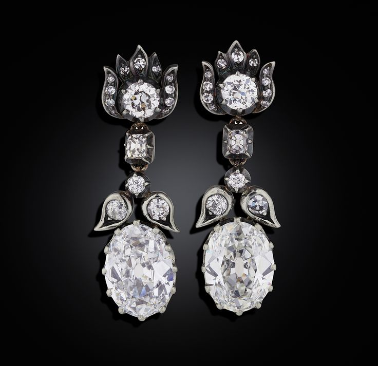 Earrings in 18K gold and silver with two large oval old-cut diamonds, 2.94 cts and 3.16 cts, with smaller old-cut and single-cut diamonds. Most likely reworked by W.A. Bolin.