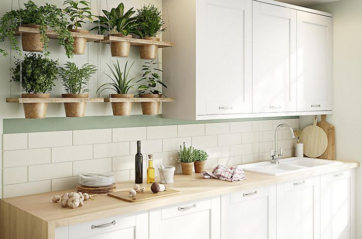 B&Q Brookfield kitchen - cream cupboards, wooden worktop, sage and cream walls