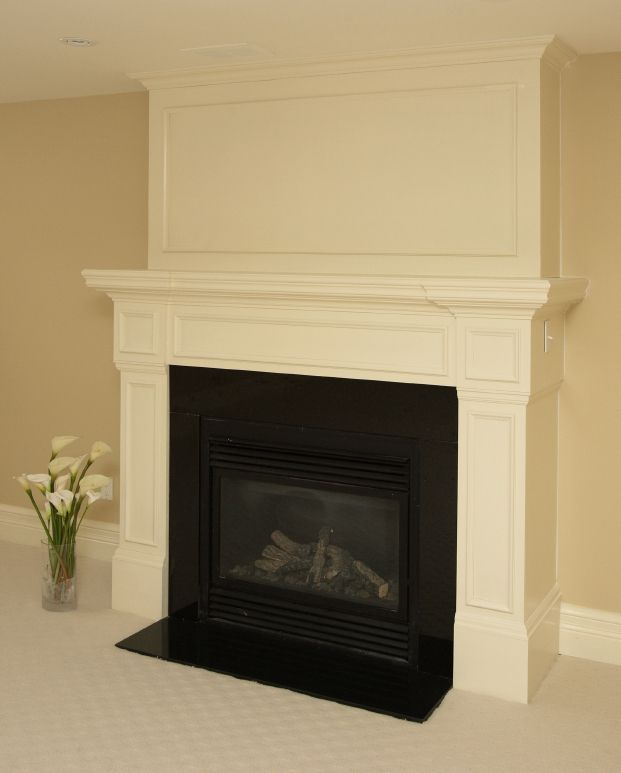 Fireplace mantle framed with crown molding above