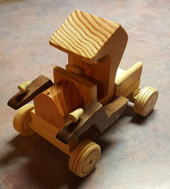 Kids of all sizes will have a blast playing with this Wooden Toy Model T Truck. I made it from many different types of wood. The body and engine are made from Fir, the base and sides are made using Pine and the fenders are made using Black Walnut. The fun part was I used almost