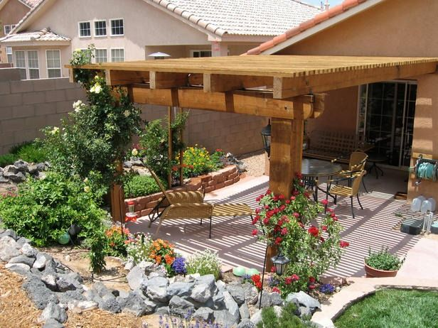 A beautiful pergola softened with climbing vines shades this southwestern patio next the view from inside the patio design by hgtv fan