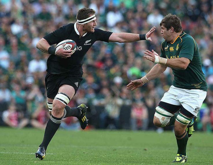 New Zealand's Kieran Read fends South Africa's Willem Alberts