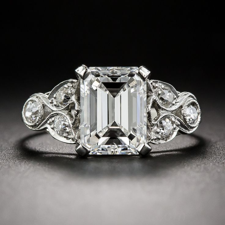 2.03 Carat GVS1 GIA Emerald Cut Diamond Art Deco Ring. An absolutely dreamy original, circa 1920s Art Deco ring featuring a bright and stunning 2.03 carat emerald-cut diamond with a GIA Diamond Grading Report stating G color and VS1 clarity. The radiant rock is showcased in an exceptionally pretty ring, with a quarter carat of sparkling diamonds set in a lovely trefoil open leaf motif on the shoulders, accentuated with delicate milgrain engraving.