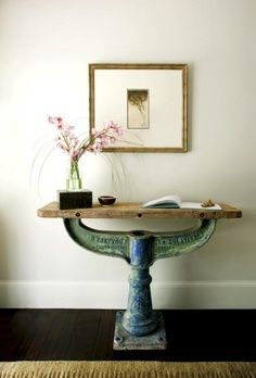 This salvaged industrial table makes a great statement piece in this hallway/ entryway