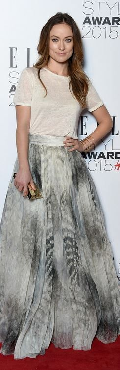 Olivia Wilde: Dress – H&M Conscious Collection  Purse – Anya Hindmarch  Jewelry – Jennifer Fisher