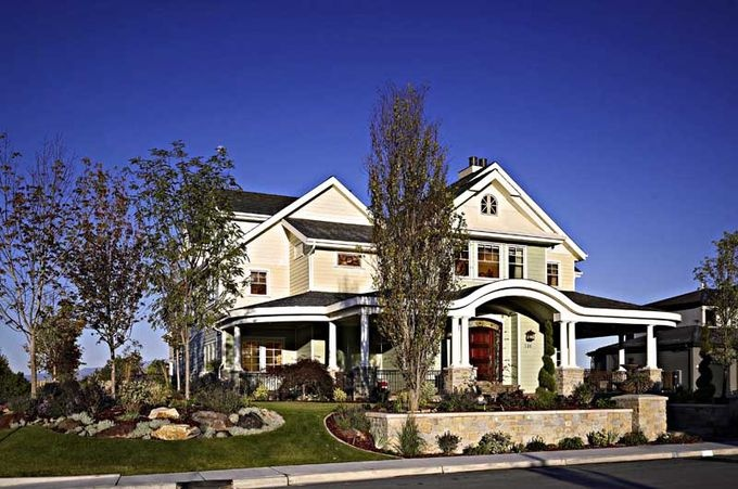 I loved this 2009 Parade of Homes (winner of landscape)  The porch was the big seller for me