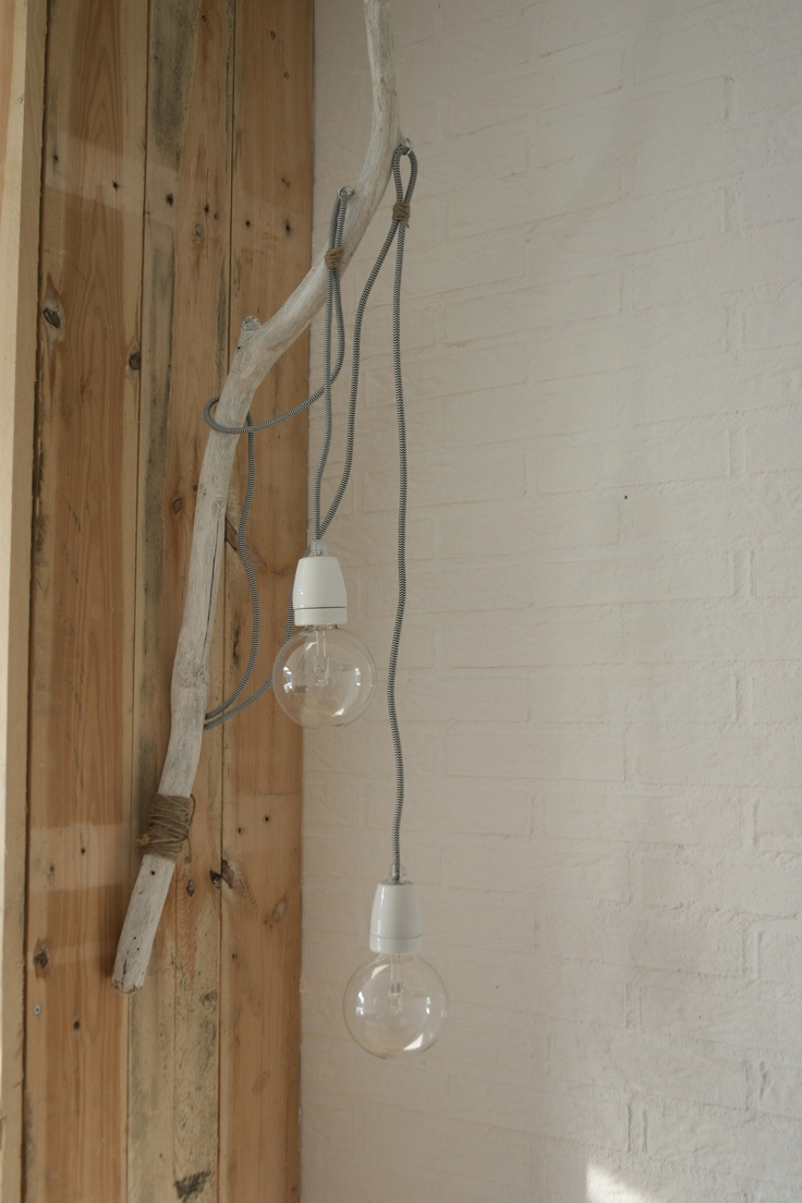 Beautiful timber branch with globe lamp. Love its simplicity.