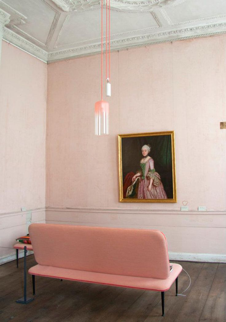 Studio WM paired this minmal, soft pink loveseat with their new gradient lamp in the pink room of the Oranienbaum Palace in Russia.  ---- 12 Times a Pink Sofa Made the Room | Design*Sponge