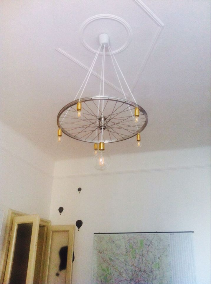 Our newest handmade chandelier made with a cycle's wheel. Recycle as a state of mind to create home design things!