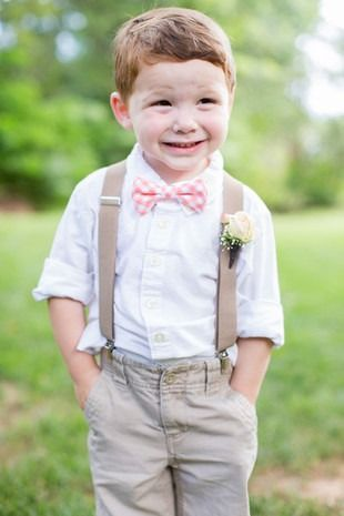 Cute ring bearer outfit- khaki pants + white shirt with pink checkered bow tie and suspenders  {Ardent Story Photography}