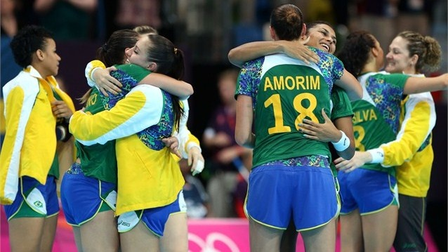 Brazil players celebrate after winning the women's Handball preliminaries Group A match between Great Britain and Brazil on Day 5 of the London 2012 Olympic Games at The Copper Box.