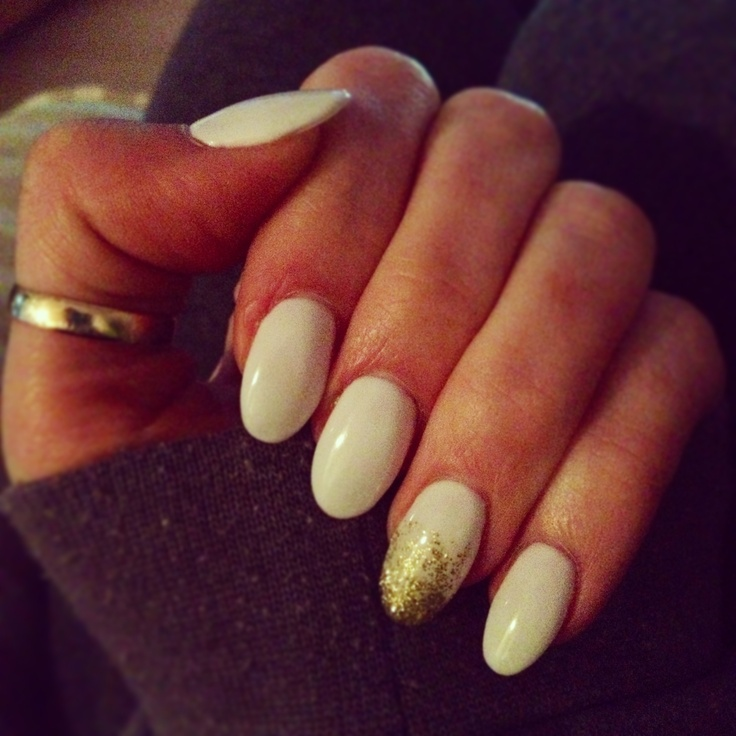 white with gold sparkle almond shaped nails nails
