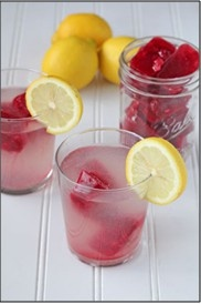 Lemonade with raspberry ice cubes.  This would be great for a party; large quantities of lemonade, guests choose from raspberry, strawberry, peach, mango, etc. flavored cubes.  YUM!! - by Repinly.com
