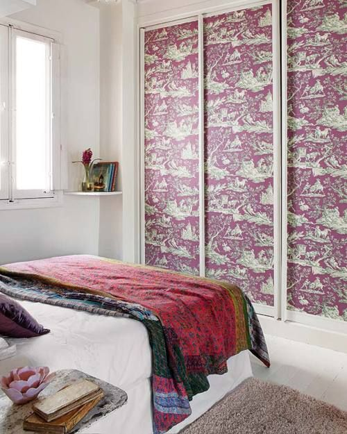 wallpapered closet doors, do this with fabric and liquid starch=great cover up for ugly feature in rental apartments