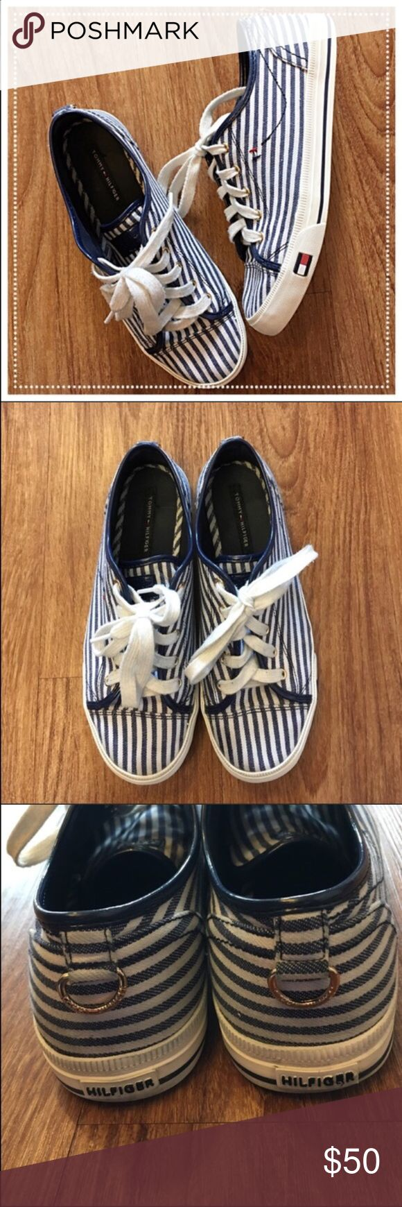 """Tommy Hilfiger blue stripe shoes golden details 📦Same day shipping (as long as P.O. is open for business). ❤ Measurements are approximate. Descriptions are accurate to the best of my knowledge.  These comfortably chic blue/white canvas shoes feature golden detailing in the lacing grommets and the back ring that is stamped """"TOMMY HILFIGER"""". These shoes are easy to wipe clean with durable rubber soles and canvas material. The only signs of wear are on the bottoms of the shoes. Only selling…"""