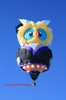 The new Owl balloon flying during a mass ascension at the 2014 Balloon Fiesta.  The special shape certainly looks like a wise owl.