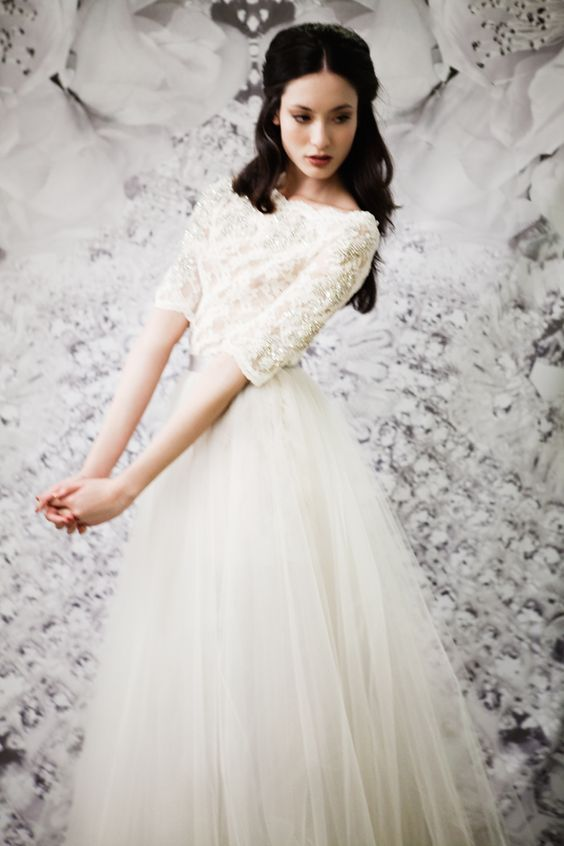 Romantic wedding dress with lace, 3/4 sleeves, boat neck and long tulle skirt. SWOON!