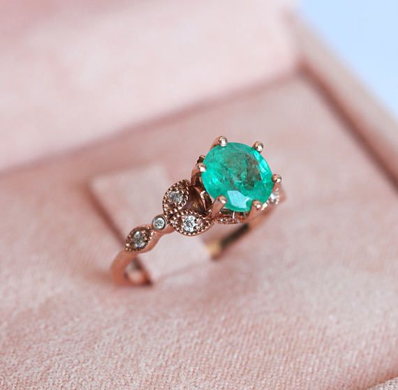 So gorgeous!! LOVE! I'd rather have the stone set in rather than the tabs but otherwise this is a perfect ring. White sapphires instead of diamonds =) =)