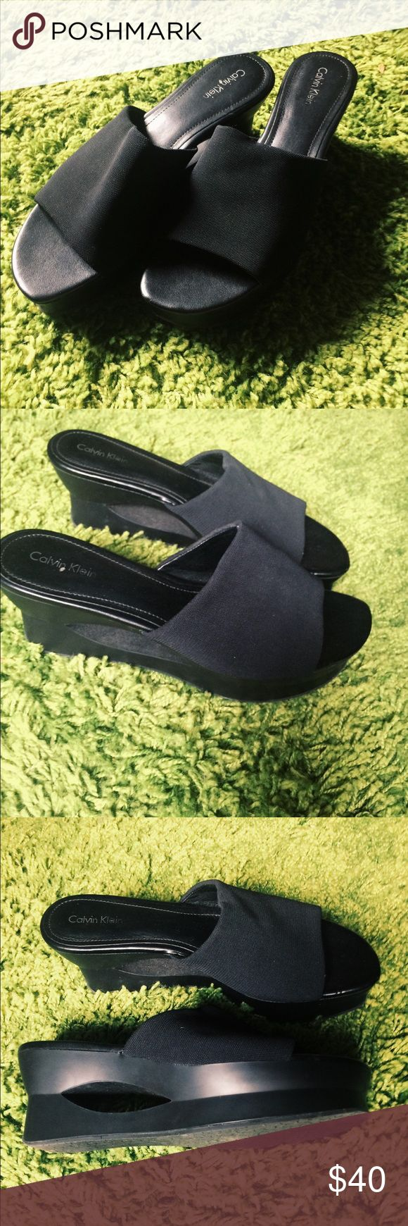 Calvin Klein 90's style slip on platforms 90's style Calvin Klein slip ons - black. Super sleek and comfortable looks great with any outfit! Size 9m Calvin Klein Shoes Platforms