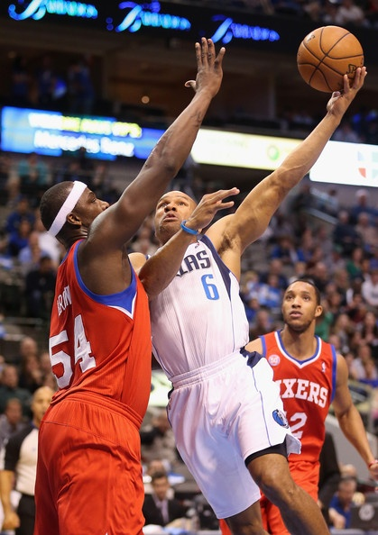Derek Fisher #6 of the Dallas Mavericks takes a shot against Kwame Brown #54 of the Philadelphia 76ers at American Airlines Center on December 18, 2012 in Dallas, Texas.
