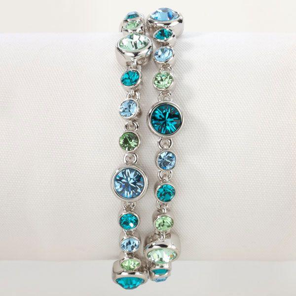 "Blue Sky Bracelet - Blue Zircon, Aquamarine, Chrysolite, and Peridot crystal; rhodium plating; 7"" to 8 ½""."
