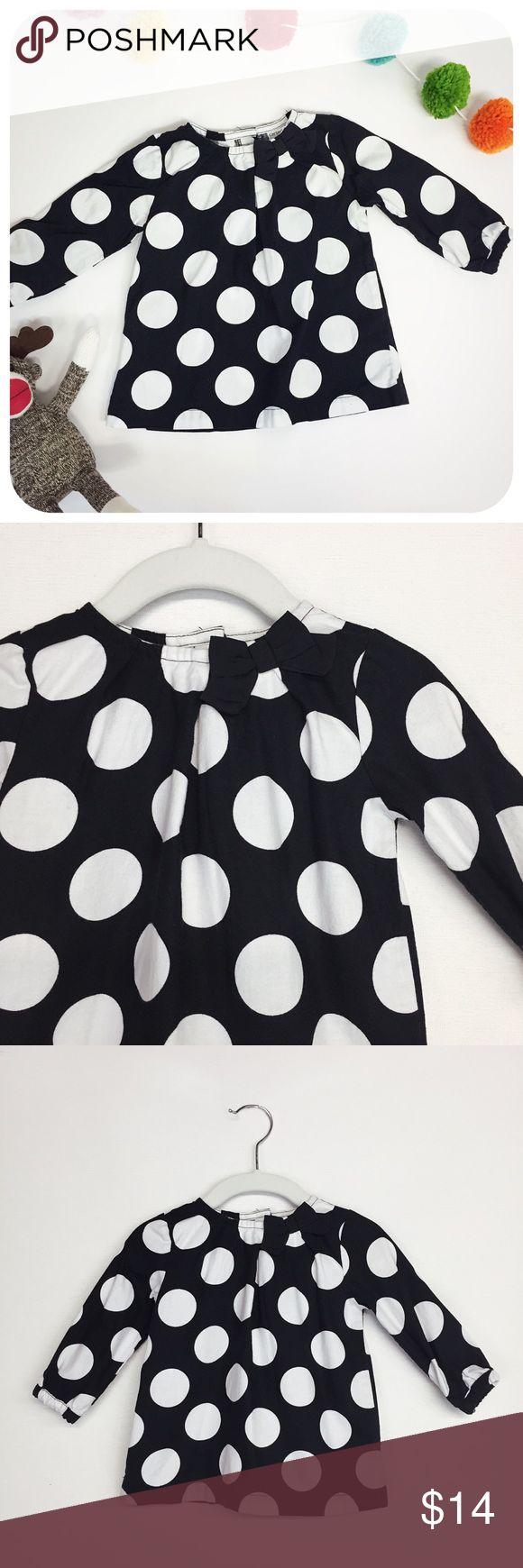 {{ Carter's }} Kids Black & White Polka Dot Tunic Carter's long sleeve polka dot shirt. Cotton voile, big white dots on black, bow at neck, swing style, button back.   {{ CONDITION }} Very Good - very minor wash wear/fading  {{ SIZE }} 12 months  {{ TAGS }} dress pretty feminine contrast color block girls kids fall winter layer christmas holidays dinner party birthday first one year circles gathered bell  {{ IF YOU LIKE... }} matilda jane . baby gap . crewcuts . janie & jack Carter's Shirts…