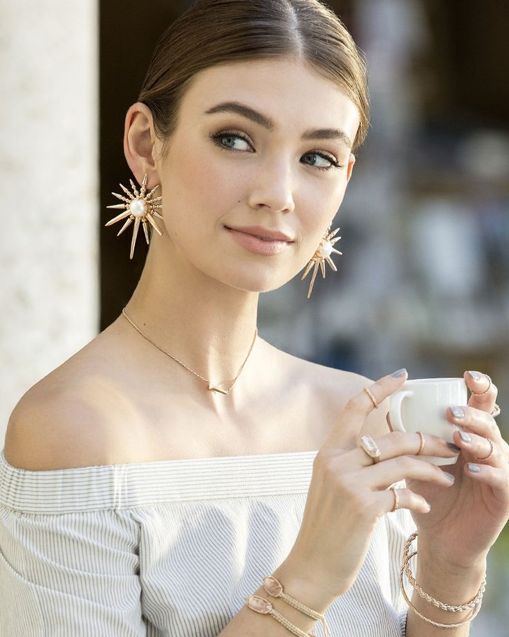 The Sayers Statement Earrings embody the warmth and energy of the Mediterranean sun reflecting on the sea. Bring a summer's glow to any ensemble when you add in these head-turning accessories.