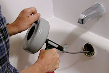 This Old House plumbing and heating expert Richard Trethewey shows how to fix a slow draining tub.