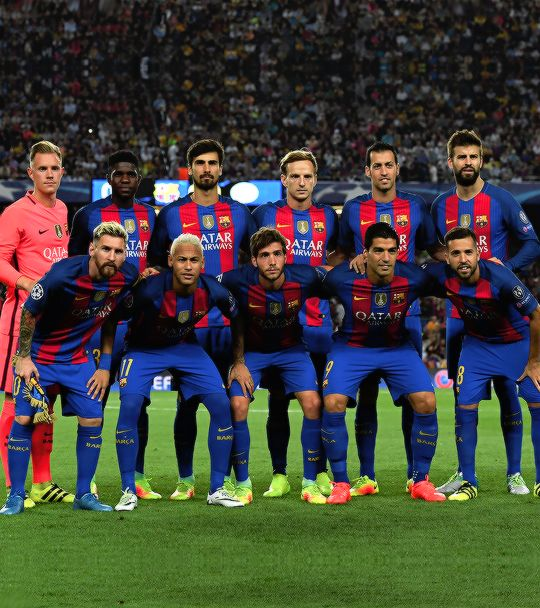 The Barcelona players line up for photos during the UEFA Champions League Group…