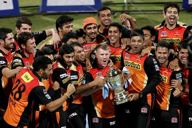 David Warner and his team-mates with the trophy.
