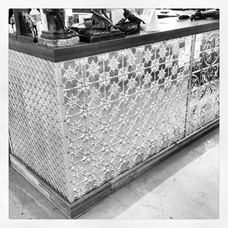 Schots counter covered in pressed metal at the Geelong store. Www.schots.com.au