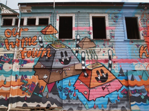 Wall mural in Kaikohe, Northland: Cracked Ink's crazy flying sponge cake pyramids